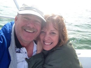 Me and my husband, Scott, on our sailboat, Jules of the Sea.
