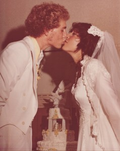 Me and my husband, Scott, getting ready to cut the wedding cake 36 years ago.