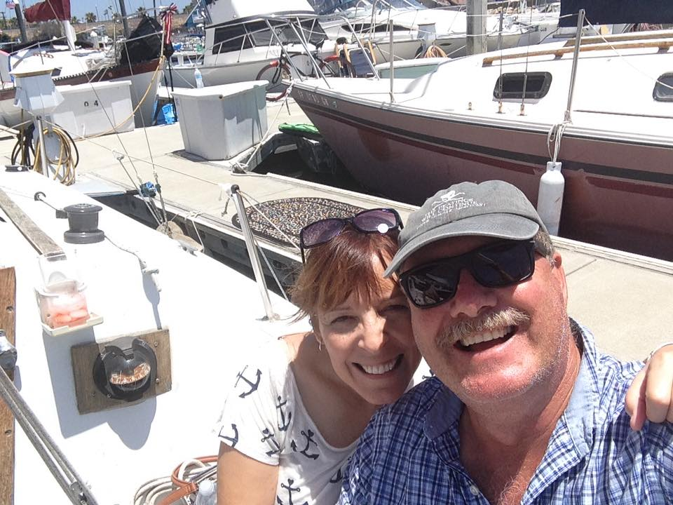 My husband, Scott, and I on our boat, the Jules of the Sea, last weekend.