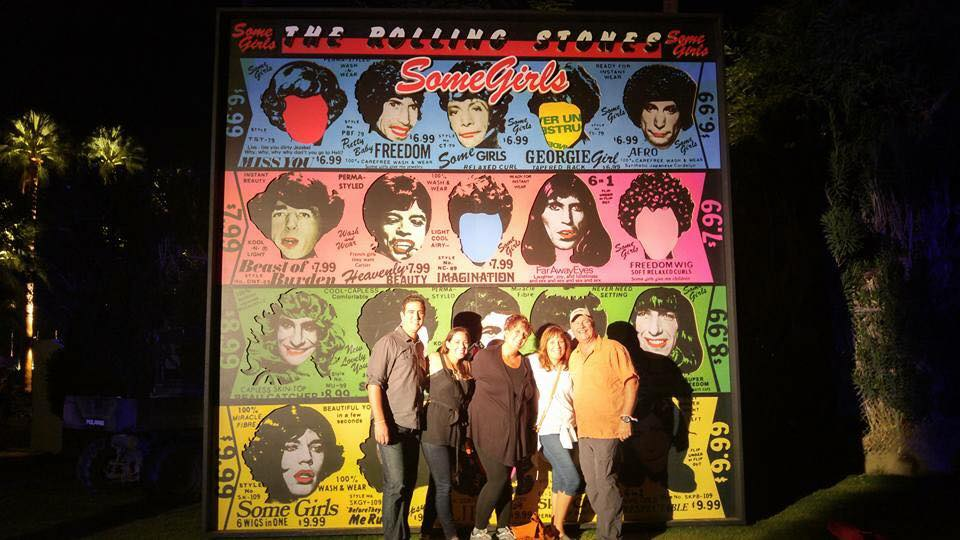 Posing in front of the Rolling Stones poster after the concert sadly ended.