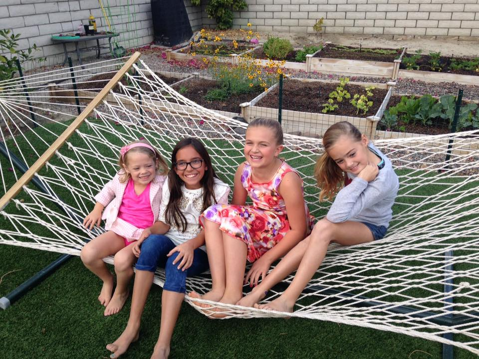My two granddaughters, niece, and friend before the Barbie spa party began.