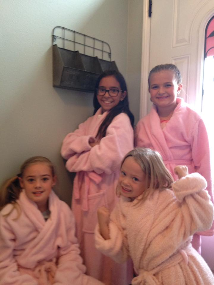 The girls decked out in their pink robes.