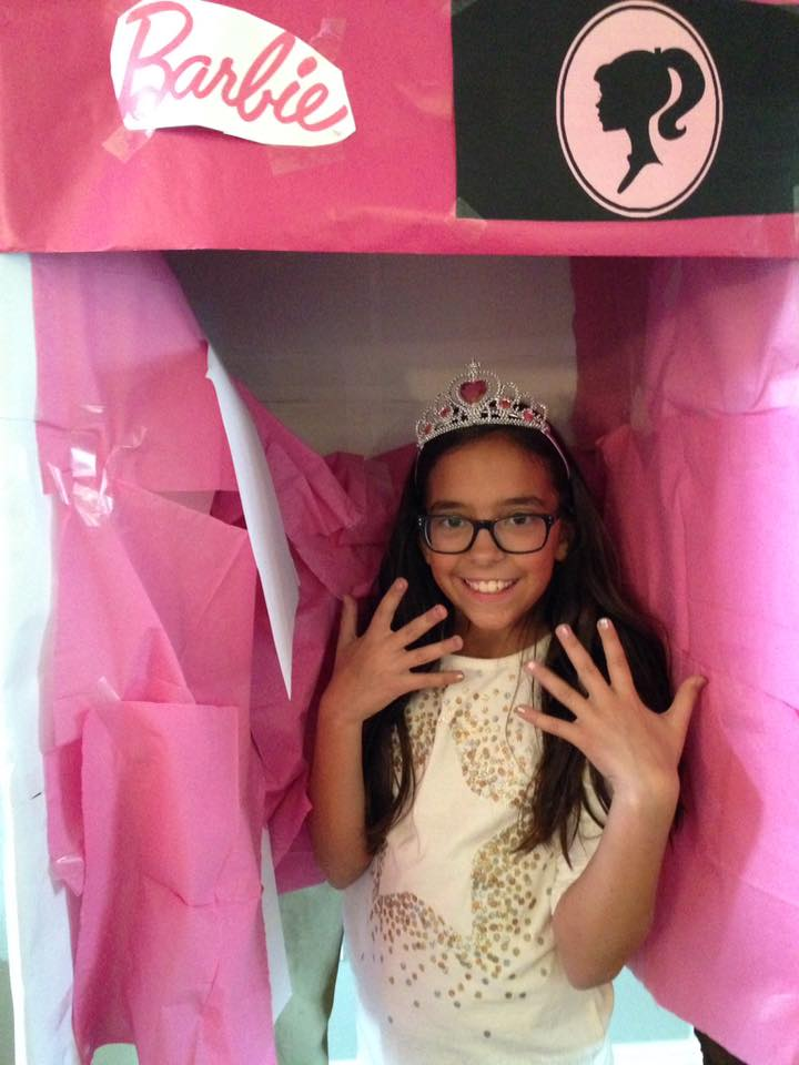 My niece posing in the Barbie photo booth.